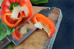 Red bell pepper on cutting board Royalty Free Stock Photo