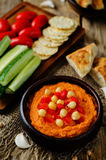 Red Bell pepper hummus with vegetables Stock Photos