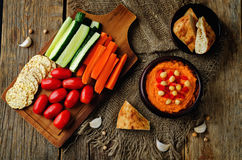 Red Bell pepper hummus with vegetables Royalty Free Stock Image