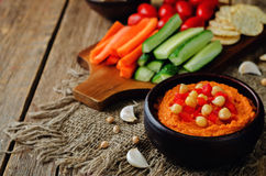 Red Bell pepper hummus with vegetables Royalty Free Stock Photos