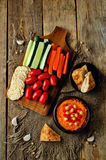 Red Bell pepper hummus with vegetables Stock Images