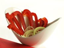 Red bell pepper, isolated. Red bell pepper slices in bowl on isolated background Royalty Free Stock Photography