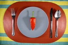 A Red Bell Pepper on a Plate Stock Photo