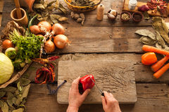 Red bell pepper prepared for cooking vegetarian meal. Stock Photography