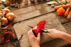 Red bell pepper prepared for cooking vegetarian meal. Royalty Free Stock Images