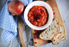 Red bell pepper relish with pomegranate syrup and seeds Royalty Free Stock Image