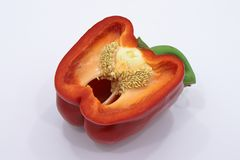 Red bell pepper in a cut. Red bell pepper in a section in front of there, how to become a salad. reminds a pharynx Royalty Free Stock Images