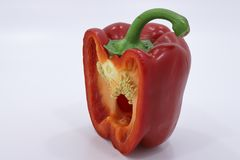 Red bell pepper in a cut. Red bell pepper in a section in front of there, how to become a salad. reminds a pharynx Royalty Free Stock Photo