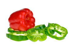 Red bell pepper and sliced green Royalty Free Stock Photos