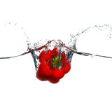 Red bell pepper thrown into a water Royalty Free Stock Image
