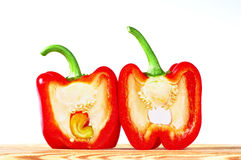 Red bell pepper on white background. Two slices of red paprika on white background stock photography