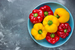 Red bell pepper and yellow bell pepper on plate Stock Photos