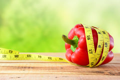 Red bell pepper with yellow measuring tape. Royalty Free Stock Images