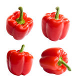 Red bell peppers. Shiny fresh red bell peppers from several angles, isolated on white background Royalty Free Stock Photo