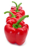 Red bell peppers. Some red bell peppers on a white background Stock Images