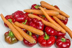 Red bell Peppers and carrots. Fresh sweet red bell Peppers and carrots Stock Image