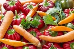 Red bell Peppers and carrots. Fresh sweet red bell Peppers and carrots Stock Photo