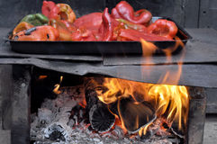 Red bell peppers on fire for ajvar Stock Photography