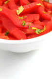 Red bell peppers in slices, with parsley Stock Image