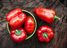 Red bell peppers.wood background.  Royalty Free Stock Image