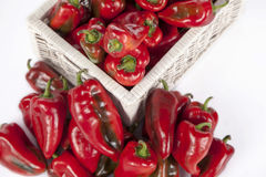 Red bell peppers in a wooden wicker basket Royalty Free Stock Image