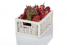 Red bell peppers in a wooden wicker basket Stock Photos