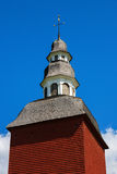 Red bell tower. Against blue sky Stock Images
