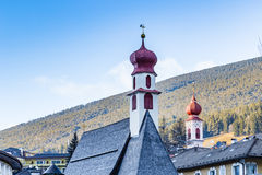 red bell towers of a mountain village Stock Images