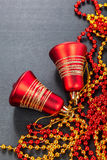 Red bells on black background. Christmas decorations Royalty Free Stock Photography