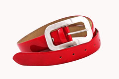 Red belt. Folded red leather belt isolated on white background stock photo