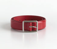 Red belt. Rolled bright red belt, leather Royalty Free Stock Photography
