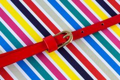 Red belt on stripes Royalty Free Stock Photo