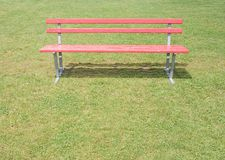 Red bench. A empy red bench in a park Stock Photography