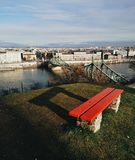 Red bench above Budapest bridge stock photos