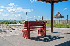 Red bench at the beach Royalty Free Stock Photos