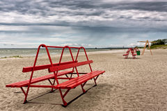 Red Bench On A Beach Royalty Free Stock Images