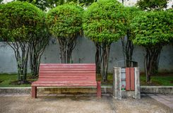 Red bench with the bin Royalty Free Stock Photography