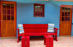 Red Bench on Blue Wall Stock Photography