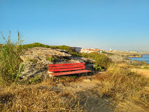 Red bench on the coastline of Peniche Royalty Free Stock Images