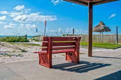 Red bench at the beach royalty free stock photo