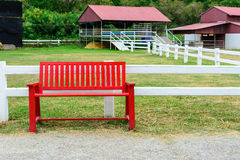Red bench in farmland Stock Photos
