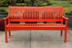 Red bench in garden Stock Photos