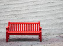 A red bench with a grey background royalty free stock photography