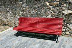 Red bench oblique Stock Photos