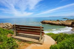 Free Red Bench On Cliff Rocks Royalty Free Stock Images - 29357799