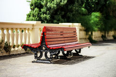 Red bench pair on the sun Stock Photography