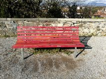Red bench. Covered with graffiti Royalty Free Stock Image