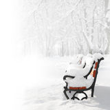 Red bench in the snow Royalty Free Stock Image