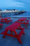 Red bench at Southwold Pier Royalty Free Stock Images