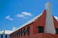 Red Bermuda building. A typical Bermuda building with red walls and a white roof Stock Image
